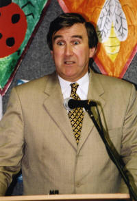 photo - Gervase Phinn - Speaking at microphone
