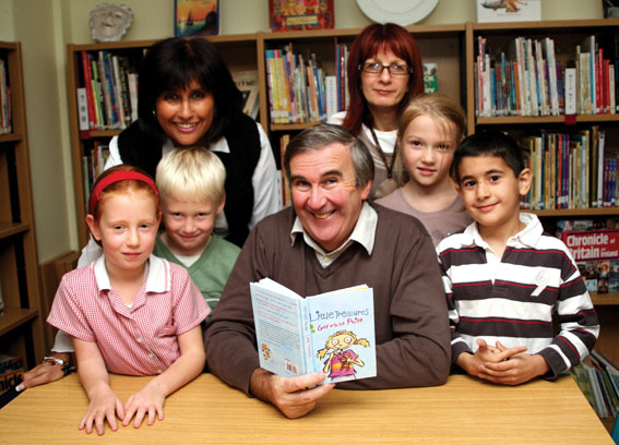 Gervase Phinn with some little treasures at Town Field Primary School