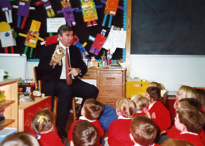Gervase Phinn with school children