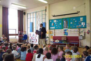 photo of Gervase Phinn in hall with children